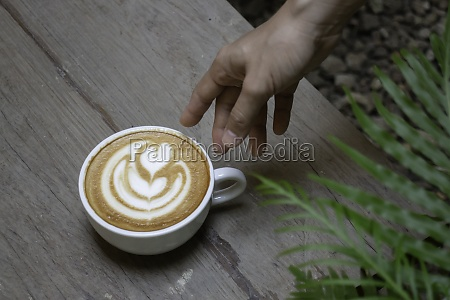 handcraft of hot milk coffee cup