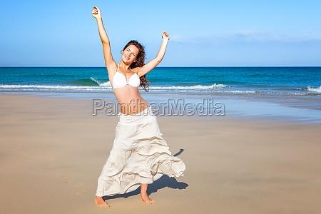 young woman enjoying the beach