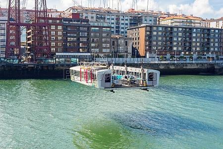 shuttle hovers under the vizcaya bridge