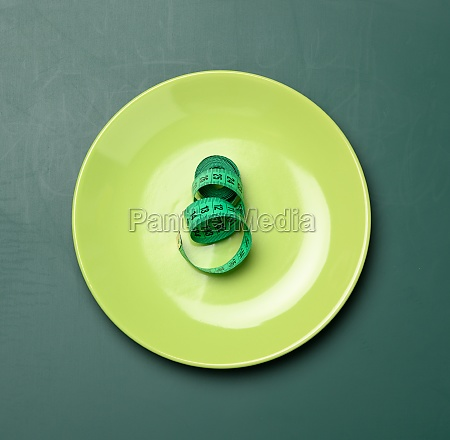 green round plate and green measuring