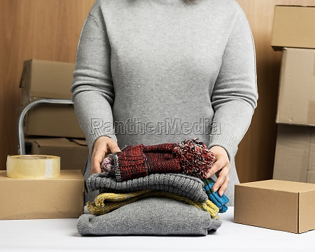 woman in a gray sweater collects