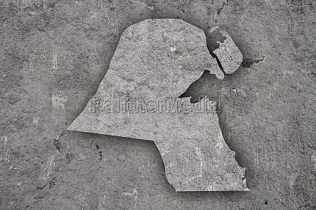 map of kuwait on weathered concrete
