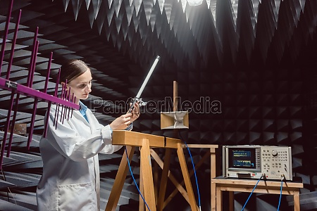 engineer in electronics lab performing rf