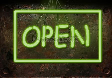 inscription open in green neon letters