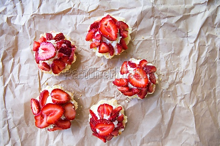 beautiful and bright cupcakes with strawberries