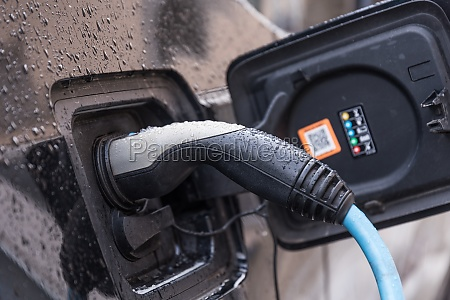 electric car connected for charging