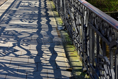 shadows from the railings on the