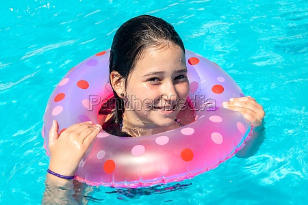 kid in a swimming pool