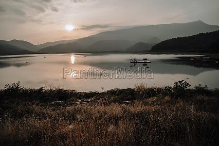 panorama scene of lake mountain sunset