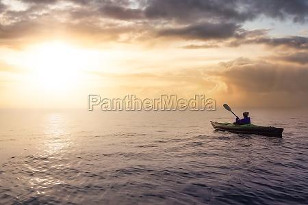 girl kayaking on an inflatable kayak