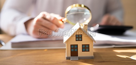 house inspection with magnifying glass