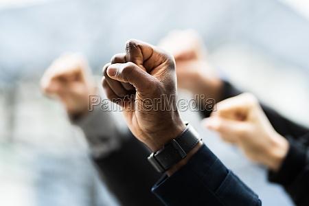 protesting raised activist fist at demonstration