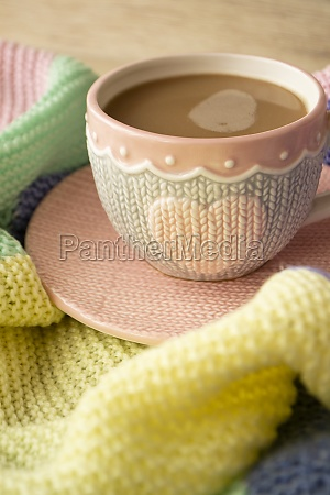 cup with cappuccino pastel plaid morning