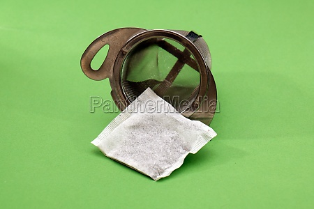 tea bag inside metal strainer