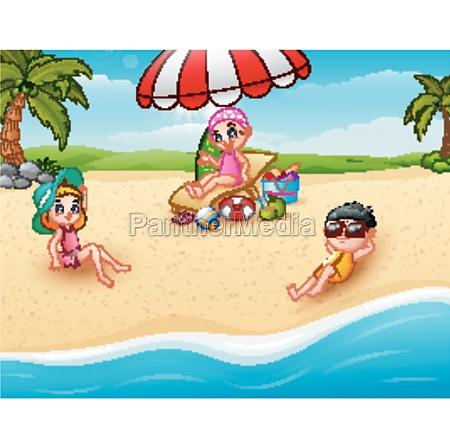 children sunbathing on the beach