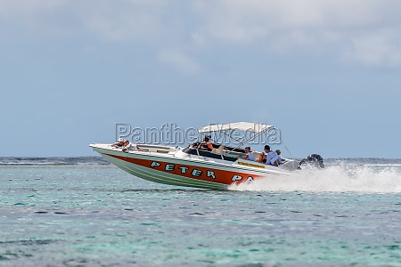 speed boat sails with tourists