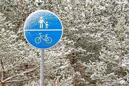 snow covered sign of a bike