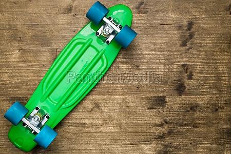 overturned green skateboard