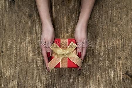 female hands holding gift