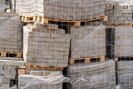 wooden pallets with gray pavement stones