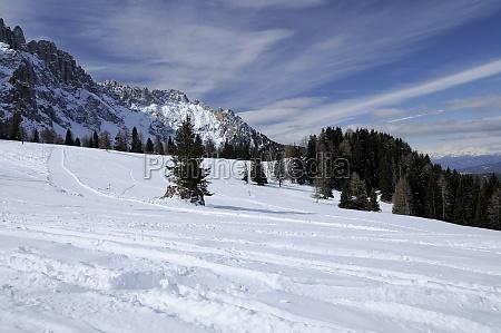 snowy slopes at costalunga pass dolomites