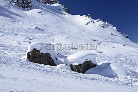 snow on stones arabba