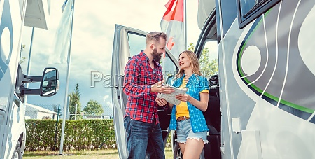 couple choosing their next vacation route