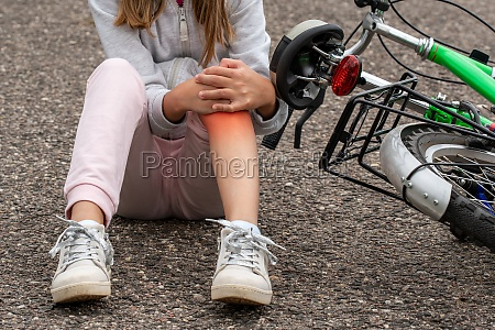 girl in pain after a bicycle