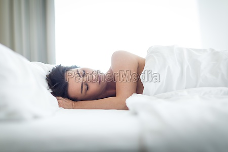 beautiful young woman sleeping in bed