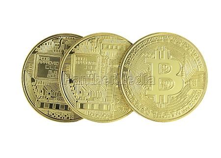three golden bitcoin coin isolated on