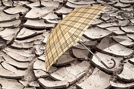 umbrella on the arid soil from