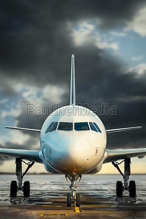 modern airplane against a dramatic sky