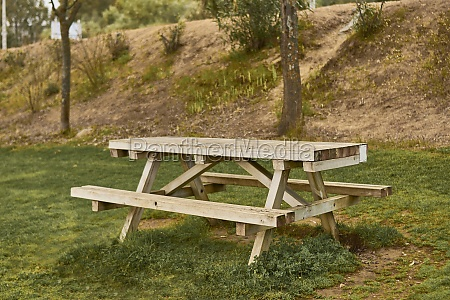 wooden table for picnics in an