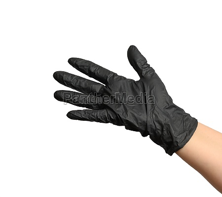 female hand in a black latex