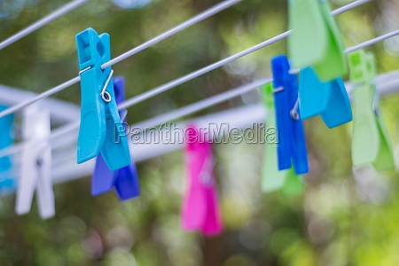 colorful clothe pegs on a clothes