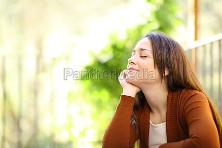 woman relaxing with closed eyes in