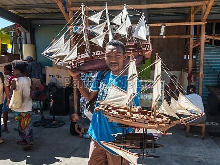 street vendor selling models of sailing
