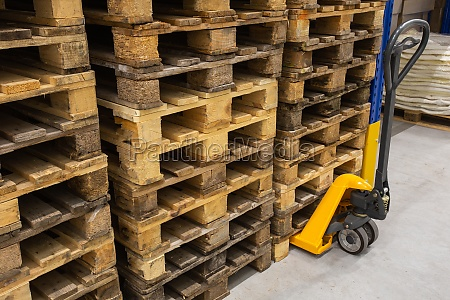 hand pallet truck with stack of