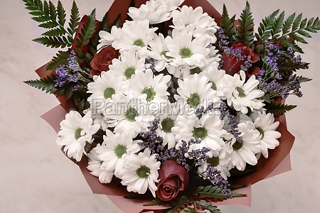 bouquet of white chrysanthemums with red