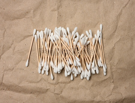 wooden ear sticks on brown craft