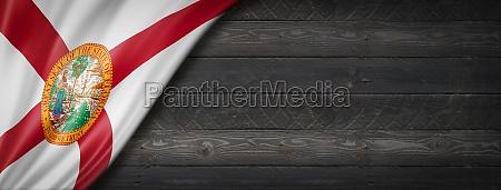florida flag on black wood wall