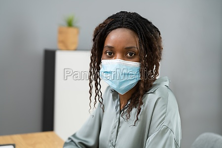 african business woman wearing face mask