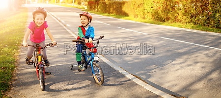 cute children riding on the bicycles