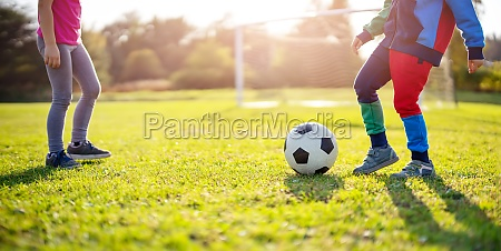 children playing football on the field