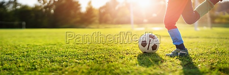 child playing football on the field
