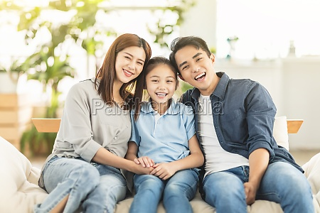 happy family smiling and hugging