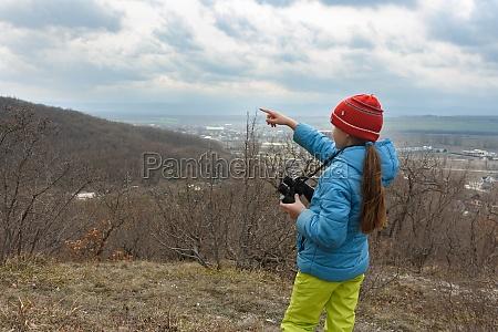 the girl saw something through binoculars