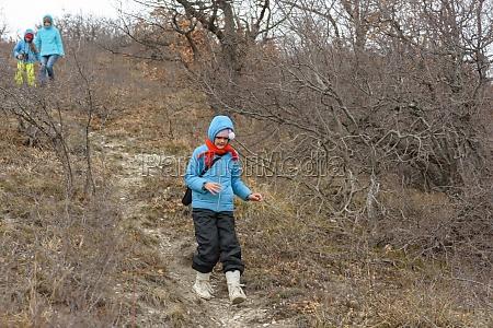 a girl runs down the path