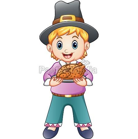 cute pilgrim boy holding a roasted