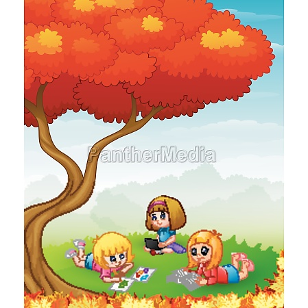 happy children studying in the autumn